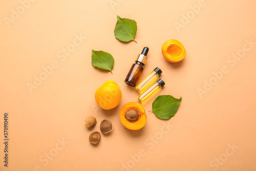 Canvas Print Bottles of apricot essential oil on color background