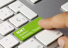 MMT Modern Monetary Theory - Inscription On Green Keyboard Key.