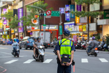 The Police Patrolling At The Crossroads To Guard The Safety Of The People