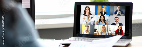 Canvas Woman talking with international colleagues using online video chat service