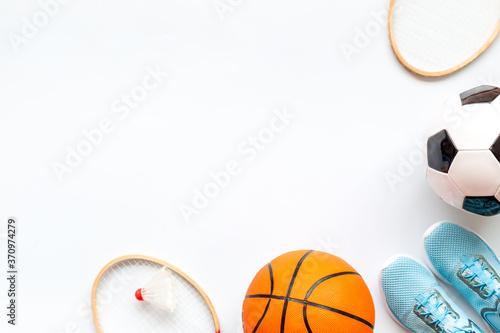 Fotografia Frame of sport balls - football, basketball, badminton on white background