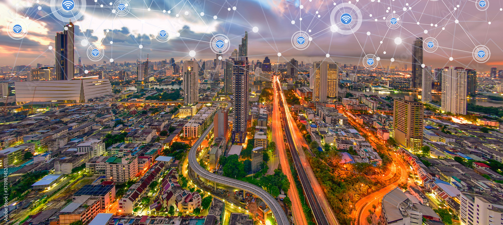 Fototapeta Modern city at twilight with network connection wireless communication concept
