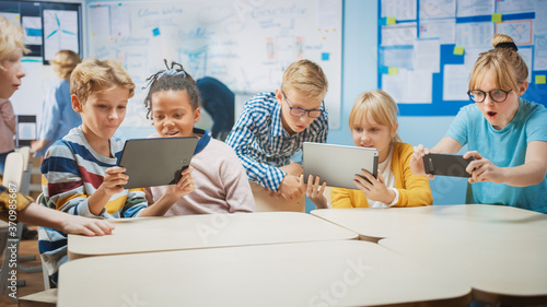 Canvastavla School Computer Science Class: Schoolchildren Use Digital Tablet Computers and Smartphones with Augmented Reality Software, They're Excited, Full of Wonder