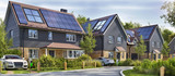 Street of beautiful residential houses with rooftop solar panels and electric cars