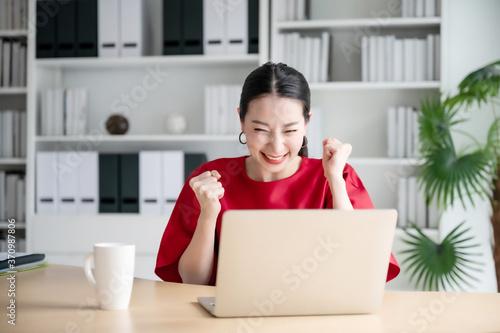 Valokuva Excited female feeling euphoric celebrating online win success achievement resul
