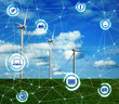 Alternative energy source. Wind turbines in field under blue sky and scheme