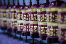 A Row Of Buddhist Prayer Wheels In The Himalayas, Nepal