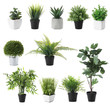 Set of artificial plants in flower pots isolated on white