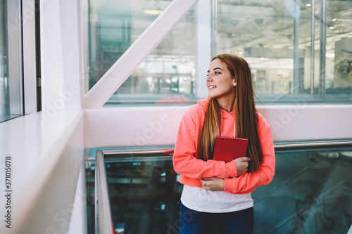 Valokuvatapetti Half length portrait of happy smiling college student with notepad in the hands