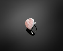 Beautiful Silver Ring Made Of Rose Quartz On A Gray Neutral Background With Reflection.