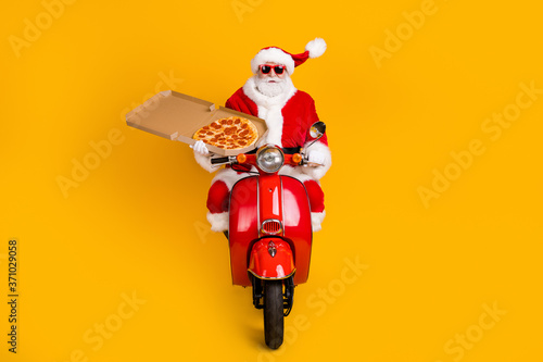 Stampa su Tela Portrait of his he nice funny Santa riding moped delivering pizza meal lunch fas