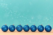 Round Shaped Sparkly Balls. Tree Decoration Placed In Row. Xmas Concept. New Year. Copy Space. Blue Festive Background