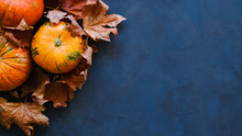 Pumpkins And Autumn Maple Leav...