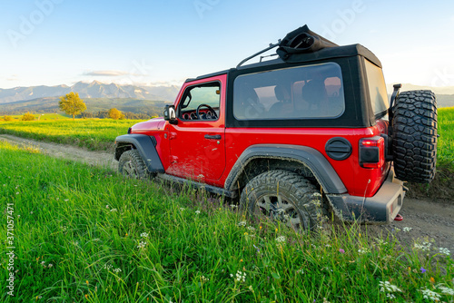 Fotografía Off-road car on a mountain road, Mountain landscape