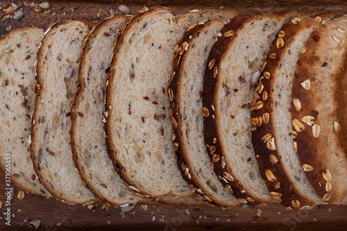 Fotografering rich and natural sliced ​​and toasted bread with grains of different elements,