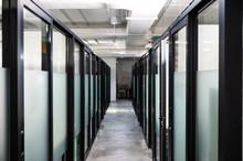 Corridor With Glass Door Partition In Modern Office