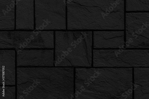 Fotografija Block pattern of black stone cladding wall tile texture and seamless background