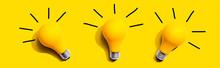 Three Yellow Light Bulbs - Fla...