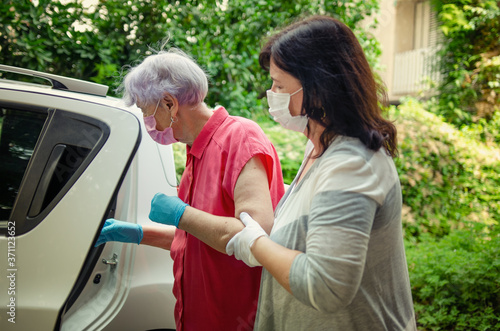 Caregiver as a medical escort to accompany an elderly client to the hospital Wallpaper Mural