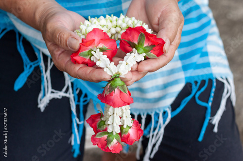 Photo Garland that is used to pay homage to mother or elders with love and respect on Thai Mother's Day or Songkran Festival