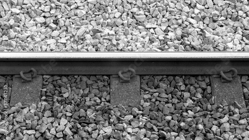 Photo close up of railway track and ballast