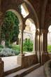 Inside view of the vaulted galleries of the courtyard of the Monastery of Poblet (cat. Reial Monestir de Santa Maria de Poblet) - Cistercian monastery. Spain.