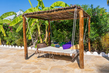 Wooden Swing With A Mattress A...