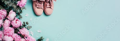 Pink sneakers, pastel pink peonies, eucalyptus flowers on pastel blue background Fototapete