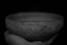 Clay Bowl Resting On A Hand  (black And White)