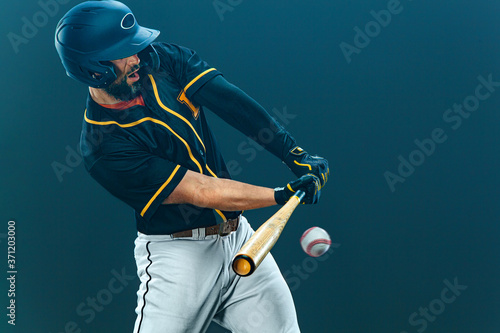 Baseball player with bat taking a swing on grand arena Fototapeta