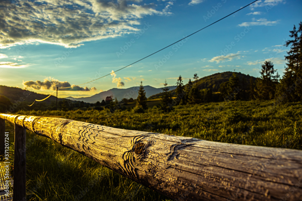 Fototapeta Bieszczady Poland. Wooden fence on a hiking trail in a mountains.