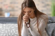 Beautiful Young Woman Praying At Home