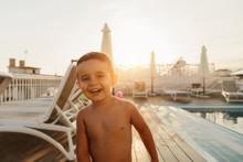 Cheerful Kid Having Fun In The Swimming Pool