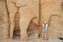Girl Exploring Rocks In Joshua Tree