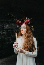 Bridal Portraits Of A Beautiful Red Haired Woman Wearing A Flower Crown