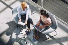 Businesswomen Talking During A...
