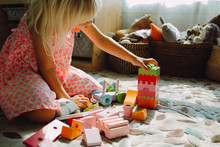 Girl Playing With Toys In A Room