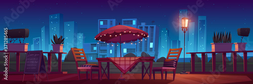 Платно Cafe or restaurant terrace with table, umbrella and chairs at night