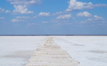 Sleepers In The Salt Crust On The Salt Lake In The Village Of Baskunchak In The Astrakhan Region Of Russia. The Largest Salt Deposit.space For Text.