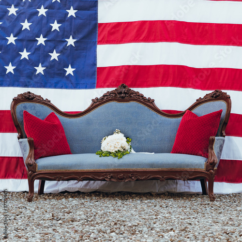 Photo Vintage Blue Sofa in front of American Flag