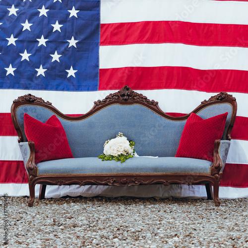Vintage Blue Sofa in front of American Flag Slika na platnu