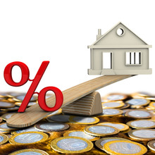 Interest On The Mortgage. Red Percentage Symbol And Symbol Of The House Weighed On The Balance Stand On The Surface Of Russian Coins. 3D Illustration