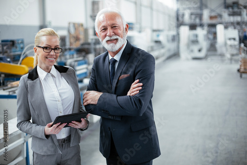 Man and woman discussing work. Colleagues working in factory Tableau sur Toile