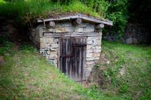 Old Cellar With Wooden Door In The Garden