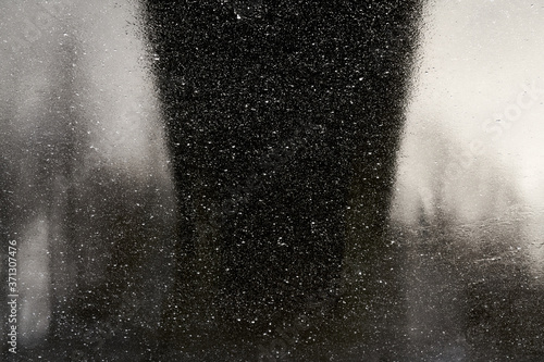 rain drops on glass and black silhouette Fototapete