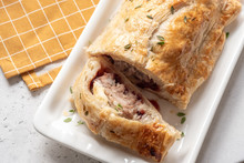 Baked Pork Sausage Rolls With Brie Cheese And Cranberry Sauce In Puff Pastry