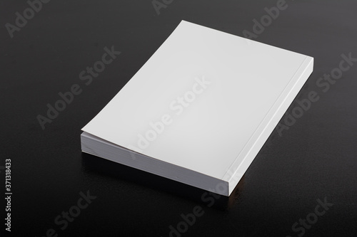 Obraz na plátně Book with blank cover on dark glossy table, editable mock-up series ready for your design, cover selection path included