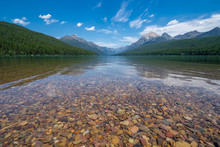 Beautiful Colored Rocks And Pebbles On The Shores Of Bowman Lake In Glacier National Park Montana. Wide Angle View