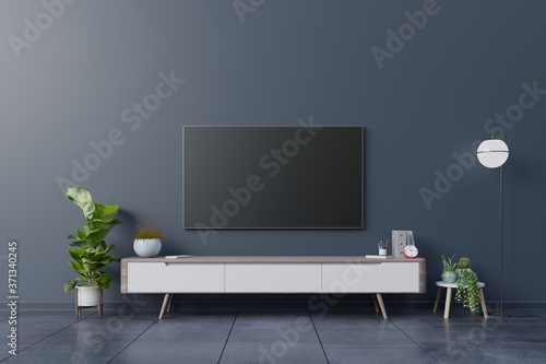 Fototapeta LED TV on the dark wall in living room,minimal design.