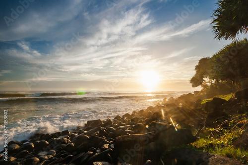 Ocean waves breaking on the rocky beach Canvas Print